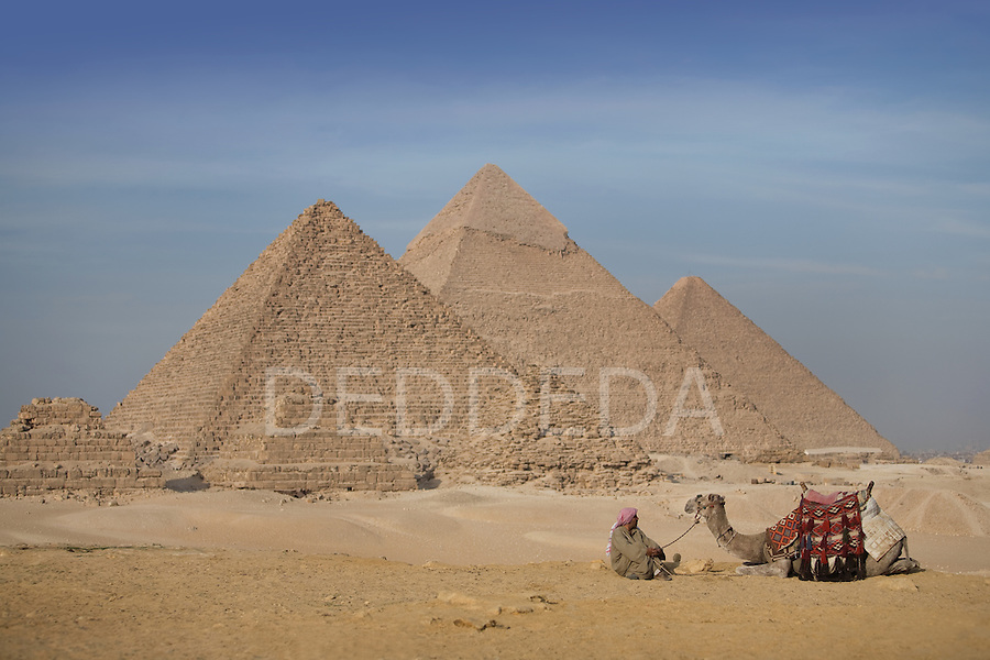 A local Egyptian man and his camel at the Pyramids of Giza near Cairo, Egypt.