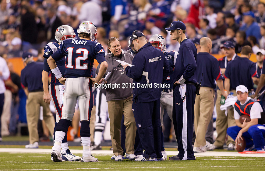 New England Patriots Head Coach Bill Belichick talks to quarterback Tom Brady (12) during the NFL Super Bowl VI football game against the New York Giants on Sunday, Feb. 5, 2012, in Indianapolis. The Giants won 21-17 (AP Photo/David Stluka)...