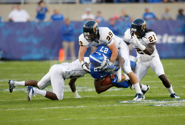 UK senior wide receiver Aaron Boyd gets tackled by Kent State defenders during the first half of the UK vs. Kent State football game at Commonwealth Stadium in Lexington, Ky., on Saturday, September 8, 2012. Photo by Tessa Lighty | Staff