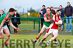 Rathmore Eoin Lawlor is pulled back by Sean Brosnan Kilcummin during the Club Championship clash in Rathmore Wednesday evening