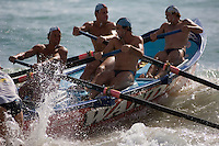 The Wanda surf rescue boat pulls away strongly at the start of a race in the annual Manly surf carnival.
