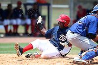 GCL Nationals Carlos Alvarez #19 slides safely into home during a game against the GCL Mets at the Washington Nationals Minor League Complex on June 20, 2011 in Melbourne, Florida.  The Nationals defeated the Mets 5-3.  (Mike Janes/Four Seam Images)