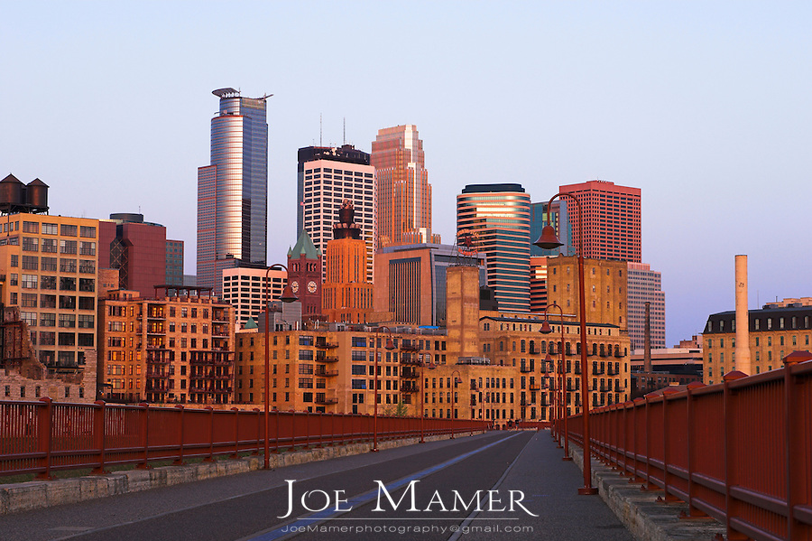 Downtown Minneapolis, Minnesota from the Stone Arch Bridge at sunrise.