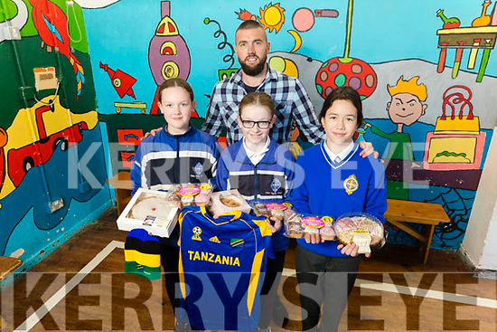 3 CBS students who raised €1,310 from their Bake Sale for the Tir na nOg orphanage in Tanzania.<br /> L to r: Cara McGuillicuddy, Sophie Jordan Banks, Ashley O'Connell and Derek O'Connor (Teacher) .