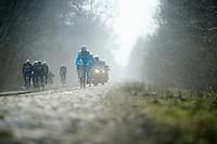 Paris-Roubaix 2013 RECON at Bois de Wallers-Arenberg..Team Astana rides the cobbles while Team Radioshack-Leopard-Trek rides alongside in the gravel