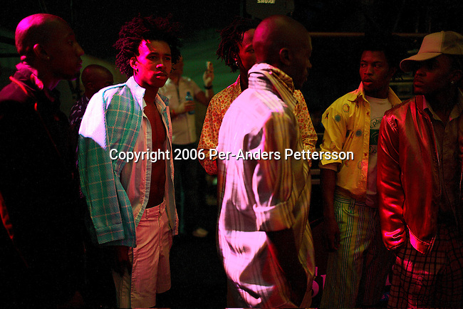 SOWETO, SOUTH AFRICA SEPTEMBER 24: Male models wait to enter the stage during a fashion show on September 24, 2006 in Soweto, Johannesburg, South Africa. The show was part of Soweto festival and all the designers and models were from the township. Soweto is South Africa?s largest township and it was founded about one hundred years to make housing available for black people south west of downtown Johannesburg. The estimated population is between 2-3 million. Many key events during the Apartheid struggle unfolded here, and the most known is the student uprisings in June 1976, where thousands of students took to the streets to protest after being forced to study the Afrikaans language at school. Soweto today is a mix of old housing and newly constructed townhouses. A new hungry black middle-class is growing steadily. Many residents work in Johannesburg but the last years many shopping malls have been built, and people are starting to spend their money in Soweto.  .(Photo by Per-Anders Pettersson/Getty Images).