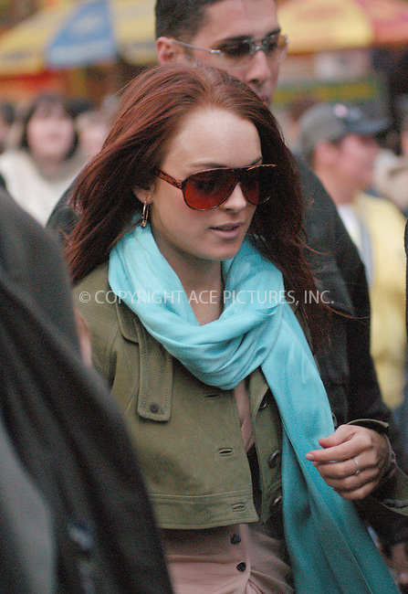 WWW.ACEPIXS.COM . . . . . ....NEW YORK, APRIL 14, 2005....Lindsay Lohan on the set of 'Just My Luck' filming in Times Square. These photos show the last scene with a kiss to silver man and then Lindsay walking back to her trailer.....Please byline: KRISTIN CALLAHAN - ACE PICTURES.. . . . . . ..Ace Pictures, Inc:  ..Craig Ashby (212) 243-8787..e-mail: picturedesk@acepixs.com..web: http://www.acepixs.com