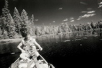 Teen boy canoeing in Algonquin Provincial Park, Ontario, Canada.