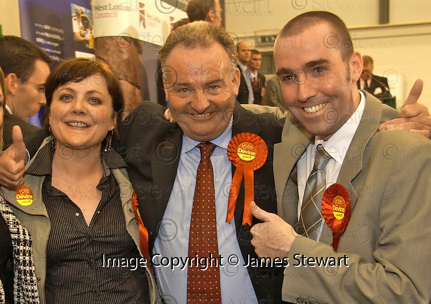 30/09/2005         Copyright Pic : James Stewart.File Name : sct_jspa12 livingston.LIVINGSTON BY-ELECTION WINNER JIM DEVINE CELEBRATES WITH HIS SON KEVIN AND DAUGHTER KATHLEEN.....Payments to :.James Stewart Photo Agency 19 Carronlea Drive, Falkirk. FK2 8DN      Vat Reg No. 607 6932 25.Office     : +44 (0)1324 570906     .Mobile   : +44 (0)7721 416997.Fax         : +44 (0)1324 570906.E-mail  :  jim@jspa.co.uk.If you require further information then contact Jim Stewart on any of the numbers above.........