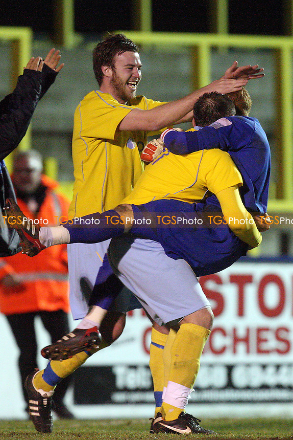 Canvey Island players celebrate their penalty shoot-out success - Canvey Island vs Dagenham & Redbridge 21/02/12 - MANDATORY CREDIT: Dave Simpson/TGSPHOTO - Self billing applies where appropriate - 0845 094 6026 - contact@tgsphoto.co.uk -NO UNPAID USE