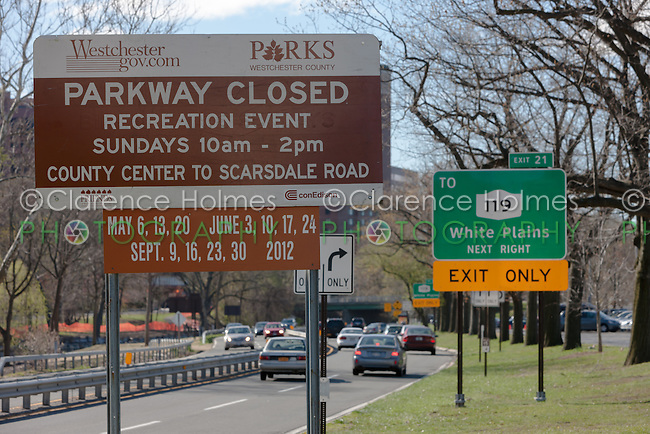 A sign shows the dates of Bicycle Sundays, when the Bronx River Parkway is closed to vehicles.