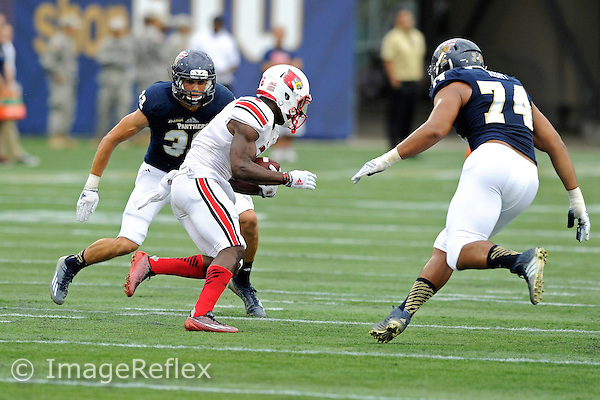 20 September 2014:  FIU safety Justin Halley (32) and defensive tackle Lars Koht (74) converge on Louisville wide receiver Eli Rogers (6) in the first half as the University of Louisville Cardinals defeated the FIU Golden Panthers, 34-3, at FIU Stadium in Miami, Florida.