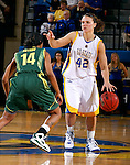 BROOKINGS, SD - NOVEMBER 23rd, 2008 : South Dakota State senior guard Ashlea Muckenhirn awaits for her teammates to get into position while driving down court and being covered by Darriel Gaynor of Oregon during their game Sunday afternoon at Frost Arena on the campus of South Dakota State University in Brookings, SD. (Photo By Ty Carlson/Inertia)