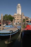 Boats moored in boat yard, with the cathedral of San Pietro di Castello in the background, Venice italy, May 2005.