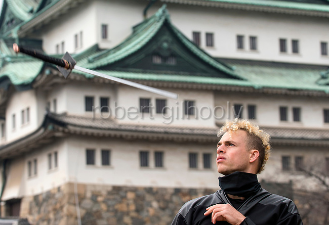 "Chris  ""Sora"" O'Neil performs a trick with his sword in the grounds of Nagoya Castle, Aichi Prefecture Japan on Feb. 23, 2017. O'Neil is one of the eight ninja corps who roam the avenues of the castle and Nagoya Airport, jumping from behind trees and bushes to surprise visitors. ROB GILHOOLY PHOTO"