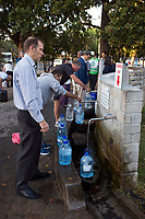 NEWLANDS, SOUTH AFRICA – FEBRUARY 7: Locals queue for free water early in the morning from a well on February 7, 2018 at SAB breweries in Newlands, outside Cape Town, South Africa. The city of Cape Town is experiencing severe water shortage and water restrictions are in place. The big users of water are not the poor in the townships, but the wealthy people in the suburbs who have pools and gardens, and who are now forced to save on water. (Photo by Per-Anders Pettersson)