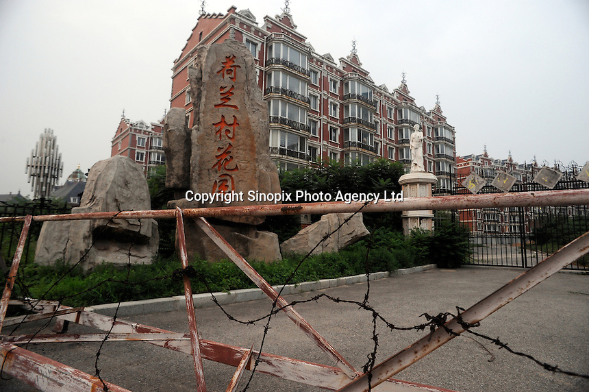 Some of the 1400 luxury aprtments are barred with a no entry sign and lie rotting in Holland Village, a 600 acre re-creation of a Dutch city on the outskirts of Shenyang lies in ruins as a monument to corruption in China. Yang, a Dutch passport, got hooked on Holland while studying horticulture at Leiden University. Yang, who built the village with some of ill gotten millions, now languishes in jail and the town that is composed of several monumental buildings, plus windmills, artificial lakes, canals, a fullsize sailing ship, 1400 luxury apartments and even an indoor beach.