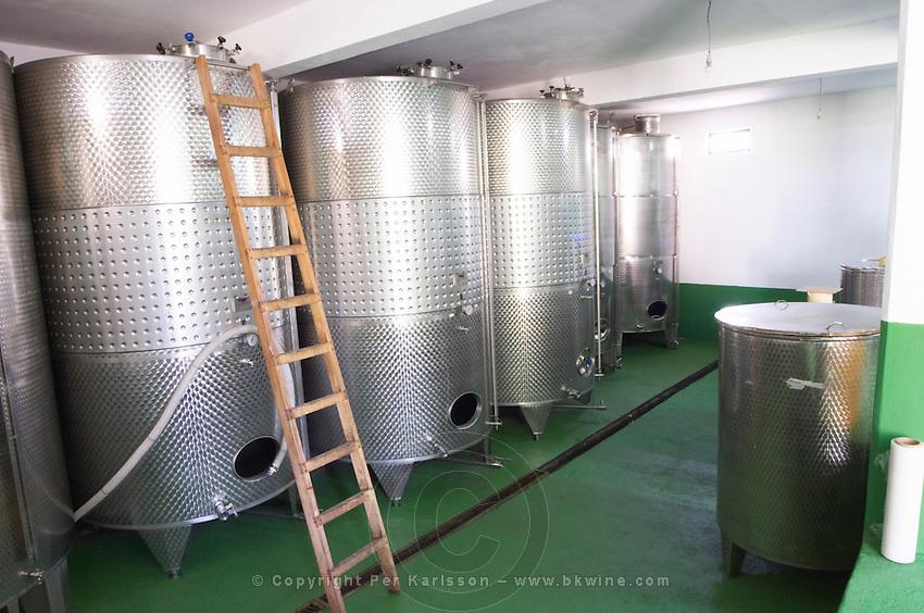 Stainless steel fermentation tanks in the winery. Vita@I Vitaai Vitai Gangas Winery, Citluk, near Mostar. Federation Bosne i Hercegovine. Bosnia Herzegovina, Europe.