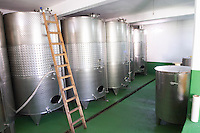 Stainless steel fermentation tanks in the winery. Vita@I Vitaai Vitai Gangas Winery, Citluk, near Mostar. Federation Bosne i Hercegovine. Bosnia Herzegovina, Europe.