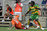 14 May 2010: Carolina's Floyd Franks (5) tries to tackle the ball away from Tampa Bay's Stanley Nyazamba (ZIM) (27). The FC Tampa Bay Rowdies defeated the Carolina RailHawks 2-1 at WakeMed Stadium in Cary, North Carolina in a regular season U.S. Soccer Division-2 soccer game.