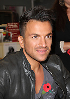 London Colney, Herts, UK - Peter Andre meets fans and signs copies of his new album 'Angels & Demons' at Sainsburys, London Colney, nr St Albans, Herts on October 29, 2012..Photo by Jill Mayhew