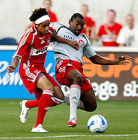 Toronto FC midfielder Marvell Wynne (16) slide tackles the ball away from Chicago Fire forward Calen Carr (3).  The Chicago Fire tied Toronto FC 1-1 at Toyota Park in Bridgeview, IL on July 7, 2007.
