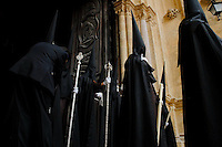 The brotherhood (Cofradía) members in their traditional penitent robes stand in the gate to the Cathedral during the Holy Week in Malaga, Spain, 2 April 2007.