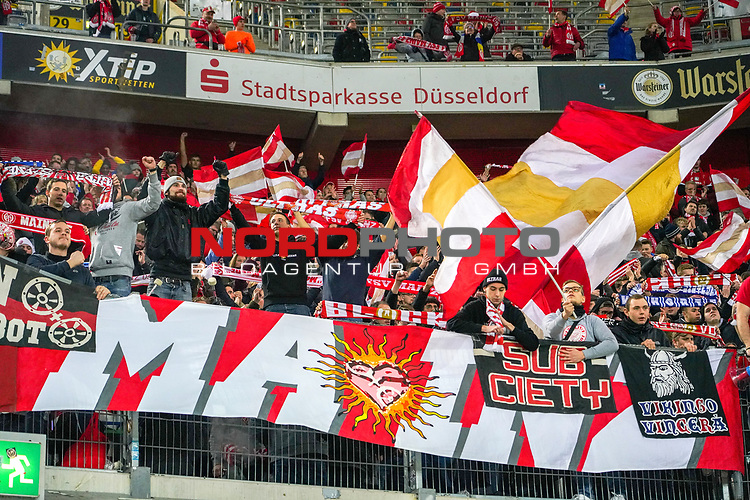30.11.2018, Merkur Spielarena, Duesseldorf , GER, 1. FBL,  Fortuna Duesseldorf vs. 1.FSV Mainz 05,<br />  <br /> DFL regulations prohibit any use of photographs as image sequences and/or quasi-video<br /> <br /> im Bild / picture shows: <br /> die mainzer Fans halten nach Ende des Spiels die Fahnen hoch und freuen sich.. <br /> Foto © nordphoto / Meuter