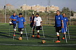 Disabled Palestinians who were lost their limbs during the Israeli wars on Gaza Strip participate in football training, in Deir al-Balah in the center of Gaza Strip on May 7, 2018. Photo by Ashraf Amra