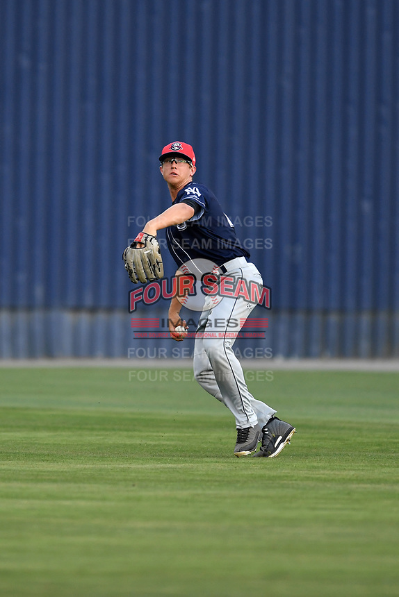 Charleston RiverDogs left fielder Blake Rutherford (23) throws the ball during a game against the Asheville Tourists at McCormick Field on July 4, 2017 in Asheville, North Carolina. The Tourists defeated the RiverDogs 2-1. (Tony Farlow/Four Seam Images)