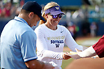 OKLAHOMA CITY, OK - JUNE 04: Head Coach Heather Tarr of the Washington Huskies exchanges lineups with Head Coach Lonni Alameda of the Florida State Seminoles during the Division I Women's Softball Championship held at USA Softball Hall of Fame Stadium - OGE Energy Field on June 4, 2018 in Oklahoma City, Oklahoma. (Photo by Shane Bevel/NCAA Photos via Getty Images)