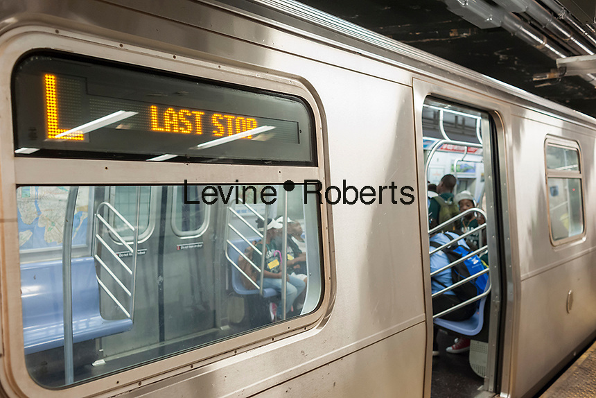"""A Canarsie Line """"L"""" train at its Eighth Avenue terminal in New York on Monday, July 25, 2016. Because of salt water damage to the Canarsie tunnel from Hurricane Sandy the MTA will close the line down in Manhattan for 18 months affecting hundreds of thousands of commuters. Trains will end at Bedford Avenue and the shutdown will start in 2019.( © Richard B. Levine)"""
