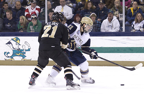November 02, 2012:  Notre Dame left wing Jeff Costello (#11) and Western Michigan forward Trevor Elias (#21) battle for the puck during NCAA Hockey game action between the Notre Dame Fighting Irish and the Western Michigan Broncos at Compton Family Ice Arena in South Bend, Indiana.  Western Michigan defeated Notre Dame 3-2.