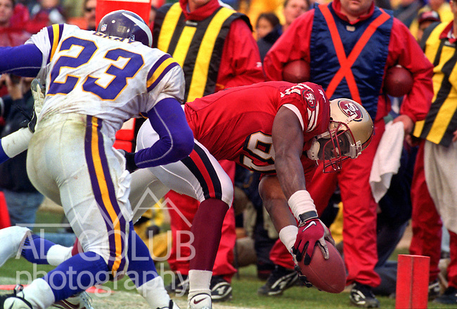 San Francisco 49ers vs. Minnesota Vikings at Candlestick Park Saturday, January 3, 1998.  49ers beat Vikings  38-22.  Minnesota Vikings defensive back Torrian Gray (23) attempts to stop San Francisco 49ers wide receiver Terrell Owens (81) from making touchdown.
