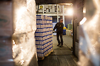Ben Ramos of A-C Motor Express of West Springfield, MA, loads his truck with pallets of pangasius at the warehouse of Preferred Freezer Services in Everett, Massachusetts. Pangasius is a type of catfish, the popularity of which is rising in food service usage across the United States.