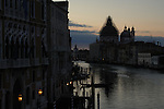 Sunrise on the Grand Canal with the background of the dome of San Maria della Salute covered in scaffolding.