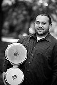 June 06, 2008. Durham, NC..North Carolina based salsa band, Orquesta GarDel.. Jose Sanchez, bongos.