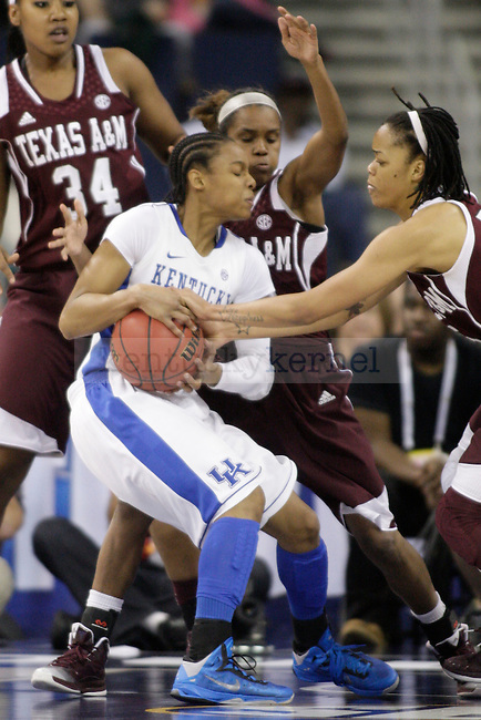TAMU players try to grab the ball from UK guard A'dia Mathies during the first half of the University of Kentucky women's basketball game vs. Texas A&M University during the SEC Tournament Championship Game at The Arena at Gwinnett Center in Duluth, Ga., on Sunday, March 10, 2013. UUK lost 75-67. Photo by Tessa Lighty | Staff