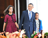 United States President Barack Obama, center, accompanied by his daughters Malia, left, and Sasha, right, arrives on the North Portico of the White House in Washington, D.C. to pardon the National Thanksgiving Turkey, Liberty, on Wednesday, November 23, 2011.  Liberty, a 19-week old, 45-pound Turkey will live out its life at George Washington's Mount Vernon Estate and Gardens in Mount Vernon, Virginia. .Credit: Ron Sachs / CNP.(RESTRICTION: NO New York or New Jersey Newspapers or newspapers within a 75 mile radius of New York City)