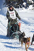 Travis Cooper on Long Lake at the Re-Start of the 2012 Iditarod Sled Dog Race