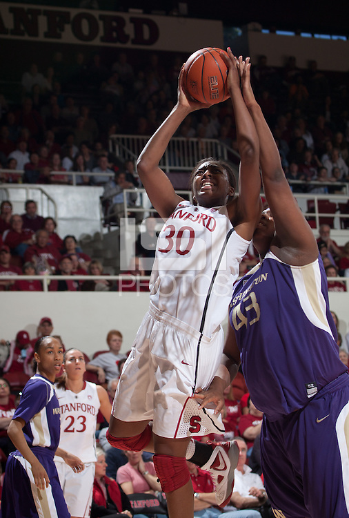 STANFORD, CA - February 12, 2011: Nnemkadi Ogwumike of the Stanford Cardinal women's basketball team is fouled during Stanford's 62-52 win over Washington at Maples Pavilion.