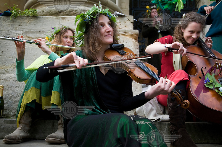Musicians come together once a year on the steps of the Bodlian Library to form a Pagan inspired Hurly Burley band,  during mayday celebrations in Oxford.