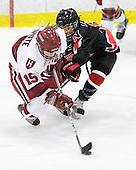 Katharine Chute (Harvard - 15), Rachel Llanes (NU - 11) - The Harvard University Crimson defeated the Northeastern University Huskies 1-0 to win the 2010 Beanpot on Tuesday, February 9, 2010, at the Bright Hockey Center in Cambridge, Massachusetts.