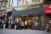 Job seekers line up outside of a branch of Jamba Juice in New York on Tuesday, March 27, 2012. The smoothie chain announced a national hiring day today, predominantly for summer jobs, but also full time positions. .Jamba Juice is hoping to hire 2500 workers.   (© Richard B. Levine)