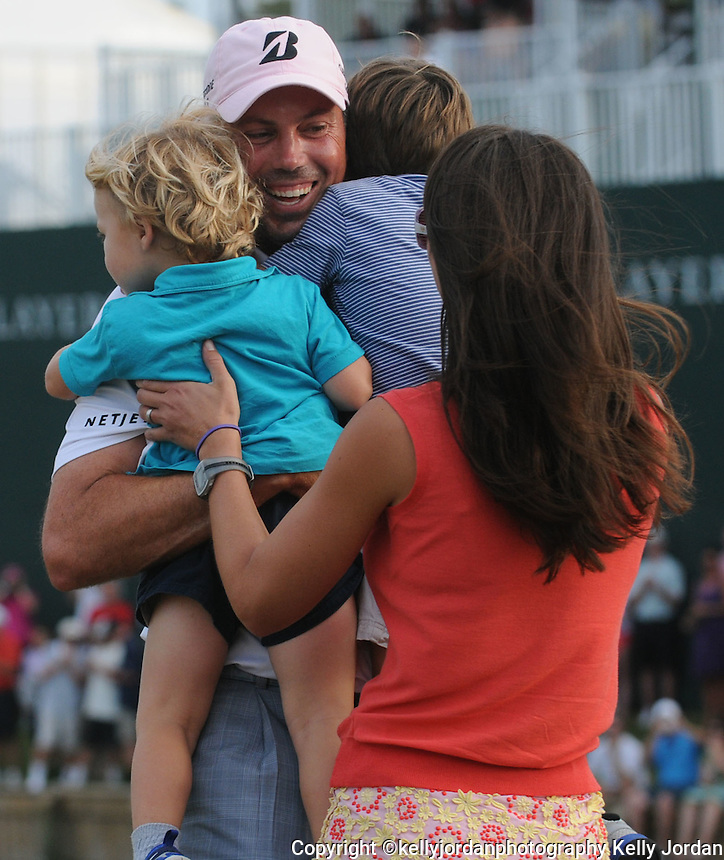 Kelly.Jordan@jacksonville.com -- 5/13/12--  Matt Kuchar won the tournament with a 13-under score and celebrates as his sons Cameron,4, and Carson,2, runs into his arms along with his wife Sybi.  The Players Championship for 2012 is played at TPC Sawgrass Players Stadium Course in Ponte Vedra Beach, FL. On Sunday May 13, 2012 the Final Round was played with Kevin Na in the lead at 12-under.      (The Florida Times-Union, Kelly Jordan)