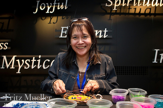 Janet Grandjambe from Fort Good Hope, NWT creates traditional beadwork and fish scale artwork