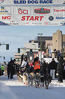 Alison Lifka and team leave the ceremonial start line with an Iditarider at 4th Avenue and D street in downtown Anchorage, Alaska on Saturday March 2nd during the 2019 Iditarod race. Photo by Brendan Smith/SchultzPhoto.com