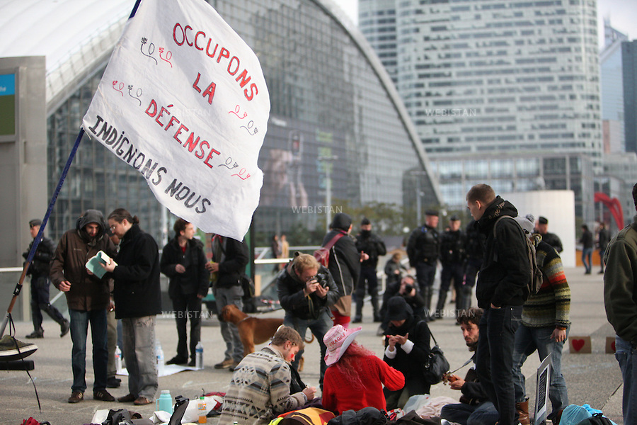 FRANCE.PARIS. 6/11/2011: The indignant people of France called for  occupying La Defense, the business district near Paris on Friday 4 of November. Many people gathered together around five o'clock in the afternoon of that day, hoping to be able to put up their tents. later that night the police took all the tents and materials and asked them to leave. Many people stayed and some returned for the weekend with their sleeping bags. They hold their general assemblies and started to organise their working group to plan the rest of their stay in La Defense.