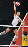 MADISON, WI - NOVEMBER 18: Audra Jeffers #15 of the Wisconsin Badgers volleyball team hits the ball against the Michigan Wolverines at the Fieldhouse on November 18, 2005 in Madison, Wisconsin. The Badgers beat the Wolverines 3-0. Photo by David Stluka.