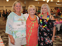 NWA Democrat-Gazette/CARIN SCHOPPMEYER Cindy Hudlow (from left), Barbara Ludwig and Nancy Hairston help welcome guests to the Beach Bingo Bash to benefit the Elizabeth Richardson Center on July 26 at the Hilton Garden Inn in Fayetteville.